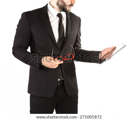 Hipster man in a classic suit isolated on a white background with a tablet in hand. High resolution.  - stock photo