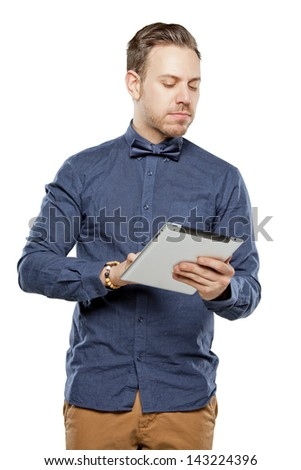 Hipster man in bow tie looking stylish using tablet