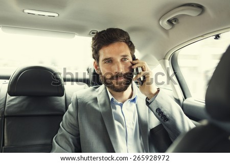 Hipster man in car on mobile phone. Filter vintage - stock photo