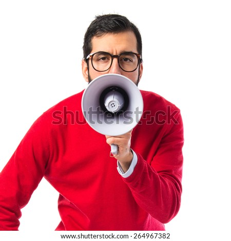 Hipster man shouting by megaphone   - stock photo
