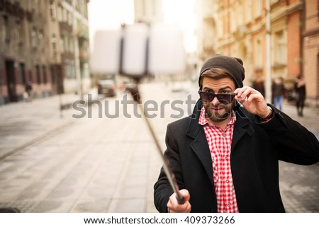 Hipster man taking selfie
