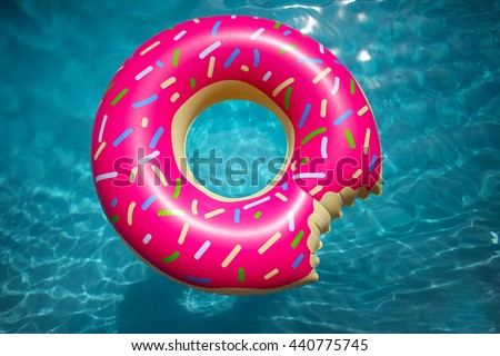 pool water with float. Hipster Sprinkled Donut Float In Sunny Pool Background Straight Down On Bright Clear Water With A