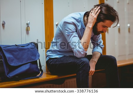 Hipster student feeling sad in hallway at the university - stock photo