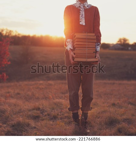 Hipster styled woman with books - stock photo