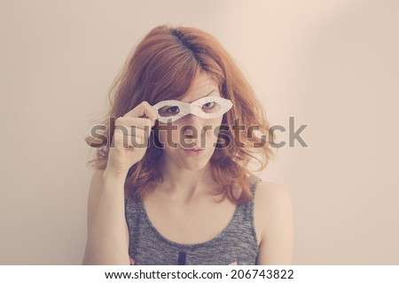 Hipster superhero girl wearing mask made of aluminum foil. Smirking and making funny face  - stock photo