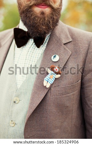 hipster with beard and brooch