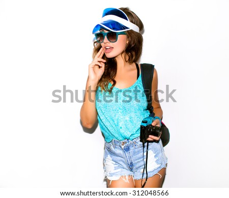 hipster woman tourist taking photo picture with camera in big European city, sexy pretty denim shirts,crop top,Girl traveler taking selfie joyful and happy smiling.Caucasian woman in her 20s,Tongue - stock photo