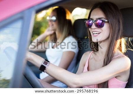 Hipster Women driving Car On Road Trip - stock photo