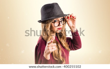 Hipster young girl pointing to the front