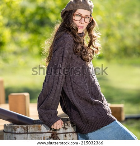 Hipster young woman in a garden - stock photo