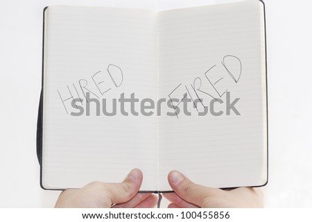 Hired/Fired choices on notepad, white background. - stock photo