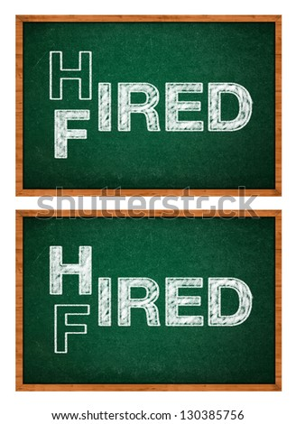 Hired or fired concept, two words handwritten on a chalkboard. - stock photo
