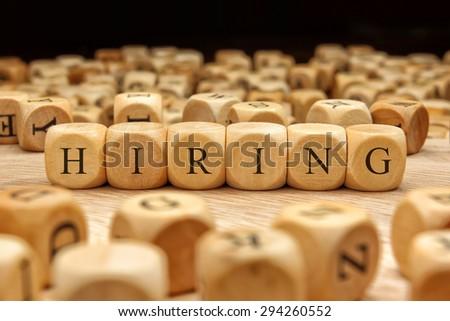 HIRING word written on wood block - stock photo