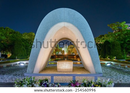 Hiroshima, Japan - April 26, 2014: View of Memorial Cenotaph in Peace Park. Cenotaph holding the names of the people killed by the bomb. The arch shape represents a shelter for the victims souls.  - stock photo