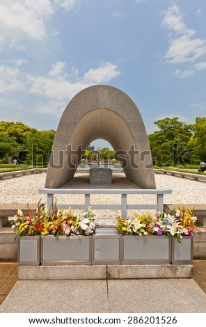 HIROSHIMA, JAPAN - MAY 20, 2015: Cenotaph (1952) of Peace Memorial Park in Hiroshima, Japan. Cenotaph holding names of people killed by the atomic bomb