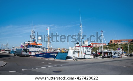 Hirtshals, Denmark - August 12, 2015: Fishery boats in the harbour of Hirtshals . This Danish seaport is important for fishing and ferry boats to Norway.