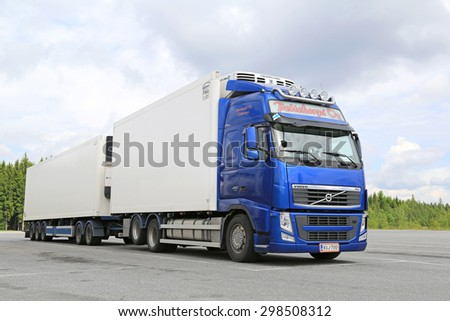 HIRVASKANGAS, FINLAND - JUNE 20, 2015: Blue Volvo FH temperature controlled truck parked. Refrigerated trucks can haul a variety of goods that require a climate-controlled handling. - stock photo