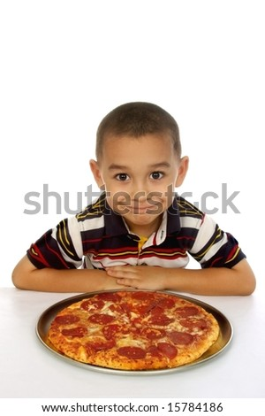 Hispanic boy ready to eat pizza on white background - stock photo