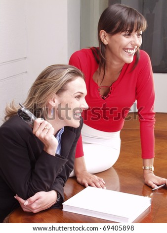 Hispanic business colleagues working at office. - stock photo