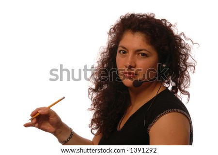 hispanic business woman with head set in office - stock photo