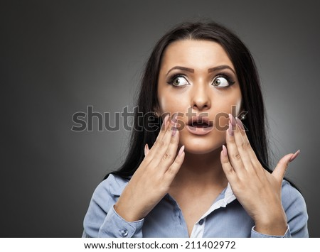 Hispanic businesswoman with an expression of shock after she discovered a big mistake - stock photo