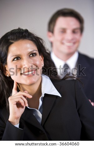 Hispanic businesswoman with male colleague