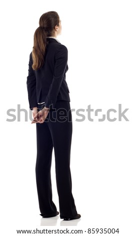 Hispanic, Caucasian mixed business woman from the back - looking at something over a white background - stock photo