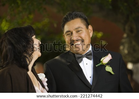 Hispanic couple in evening wear