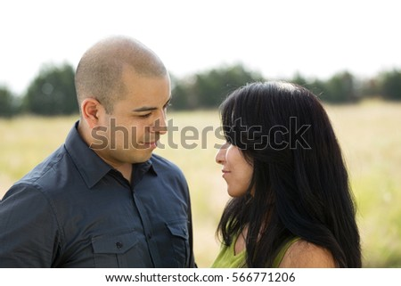 Hispanic couple talking.