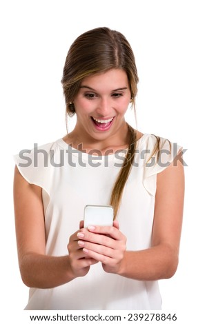 Hispanic cute young woman with surprise expression looking at phone. Image isolated on white with clipping path. - stock photo