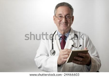 Hispanic doctor physician writing prescription - stock photo
