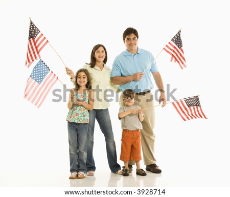 Hispanic family holding American flags. - stock photo