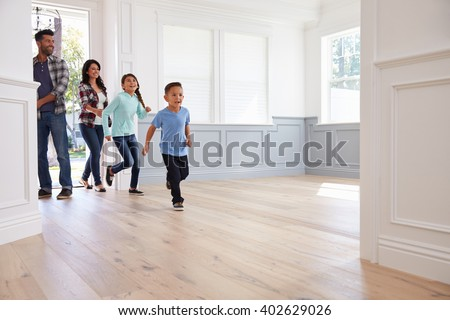 Hispanic Family Viewing Potential New Home - stock photo