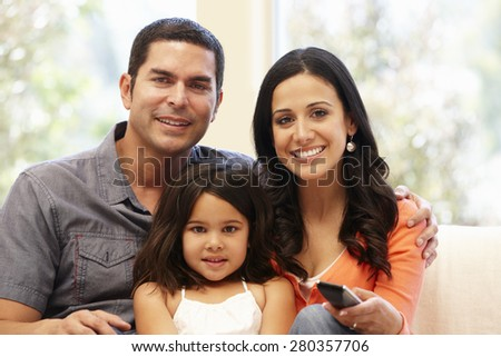Hispanic family watching television - stock photo