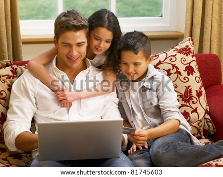 Hispanic father and children shopping online