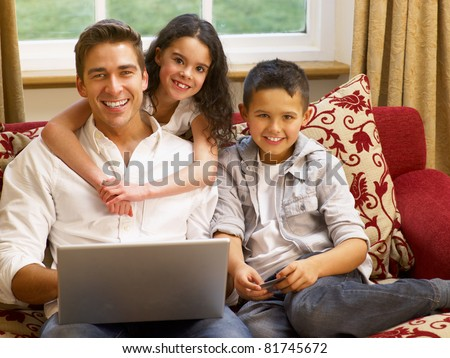 Hispanic father and children shopping online - stock photo