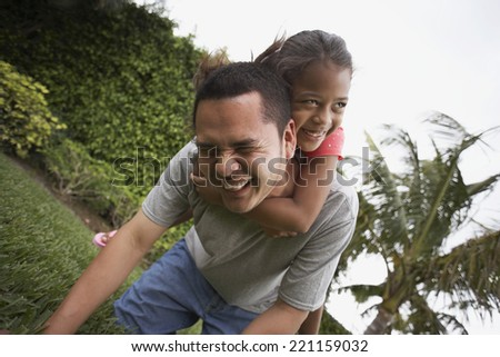 Hispanic father and daughter playing - stock photo