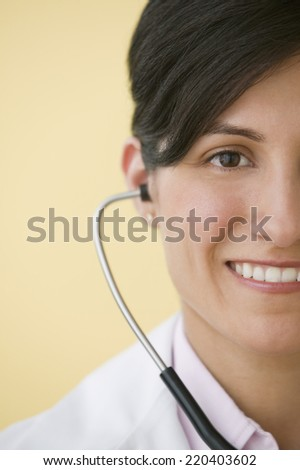 Hispanic female doctor with stethoscope - stock photo