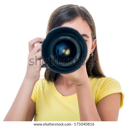 Hispanic girl taking a picture using a professional camera isolated on white - stock photo