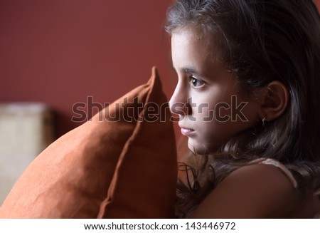 Hispanic girl watching television late at night - stock photo