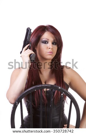 Hispanic girl with guns on a chair isolated on white background - stock photo