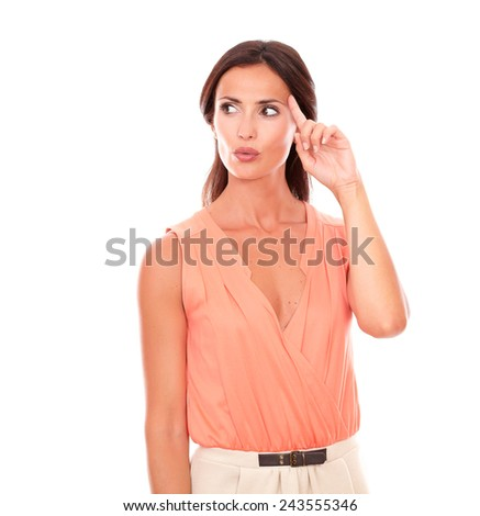 Hispanic lady looking to her right wondering about a question while standing in white background - copyspace - stock photo