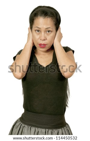 Hispanic, Latin middle aged woman in shock or disbelief - stock photo