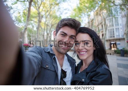HISPANIC LOVE COUPLE HAPPY SELFIE - stock photo