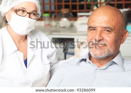 Hispanic man at the dentist - stock photo