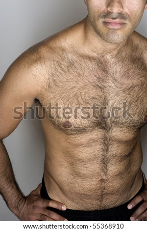 hispanic man's abs - stock photo