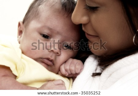 Hispanic mother holding child - stock photo