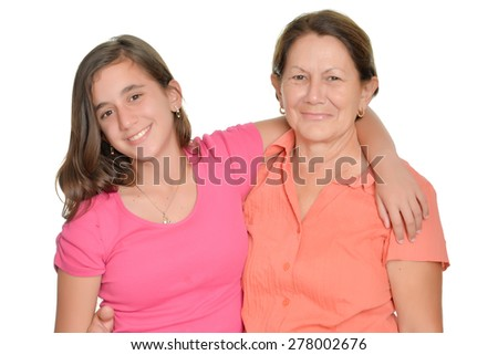 Hispanic teenage girl and her grandmother hugging and smiling isolated on white - stock photo