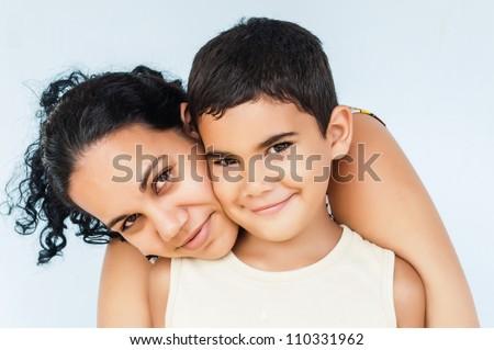 Hispanic woman hugging her young son - stock photo