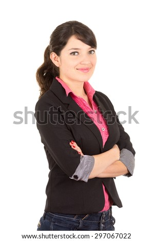 Hispanic woman in pink shirt and black blazer jacket with arms crossed side angle. - stock photo